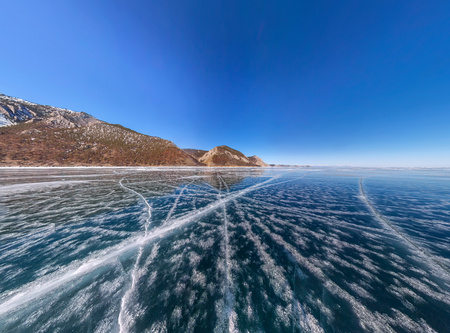 Patterns of cracks on a blue winter ice of Lake Baikal from Olkhon