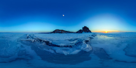 Big cracks in the ice of Lake Baikal at the Shaman Rock on Olkhon Island. Spherical 360 degree vr panorama. Фото со стока