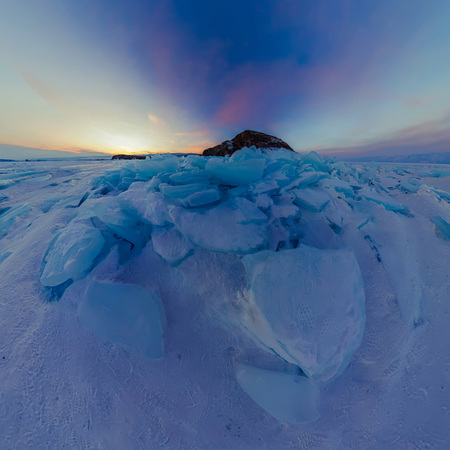 Purple dawn of ice hummocks on Lake Baikal on the island of Olkhon