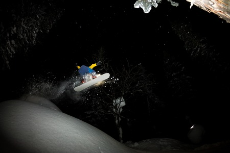 freerider rides at night on powder snow blows up Фото со стока - 108775210