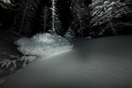 freerider rides at night on powder snow blows up Фото со стока - 108775214