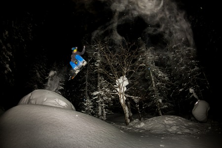 freerider rides at night on powder snow blows up Фото со стока - 108775216