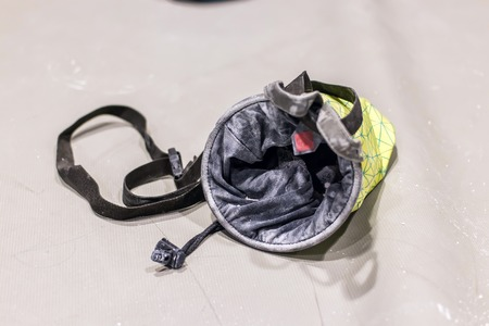 climbing bag for magnesia lies on the mat isolate