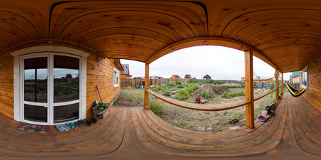 The interior of the veranda in a wooden house of beams, spherical 360vr panorama