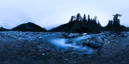 Mountain river in the middle of the forest at the blue hour on a long exposure. Spherical panorama 360vr