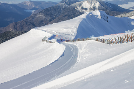 Lines of velveteen fresh ski slopes on Mount Rosa Khutor in Krasnaya Polyana.