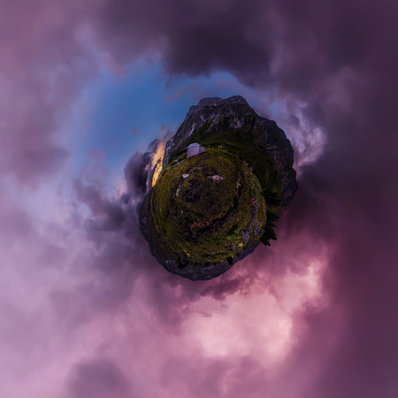 tent in the mountains against the backdrop of purple clouds at sunset. Tiny planet 360vr panorama. Фото со стока