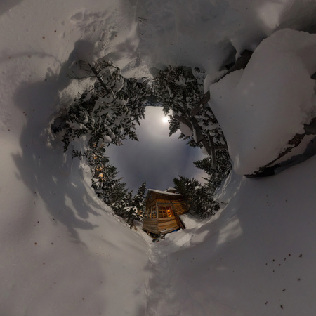 Panorama house chalet during a snowfall in the trees winter forest at night in the moonlight. Tiny planet 360 panorama