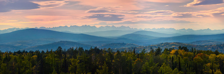 Wide angle panorama autumn forest,misty hills mountain tops in pink dawn Фото со стока