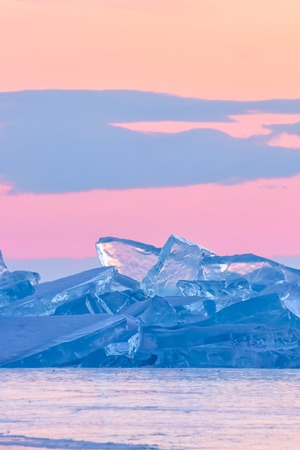 blue toros of Baikal against the background of the pink sky of the dawn and purple clouds