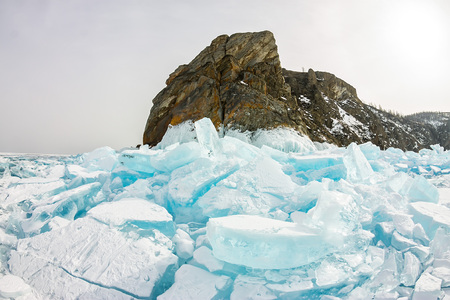 Cape Khoboy rock on Olkhon Island, Lake Baikal, ice hummocks in winter, Russia, Siberia