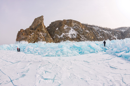 Cape Khoboy rock on Olkhon Island, Lake Baikal, ice hummocks in winter, Russia, Siberia Фото со стока - 119772084