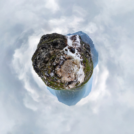 Mountain waterfall stream in misty rainy weather in the valley. Tiny little planet 360 Фото со стока - 119848854