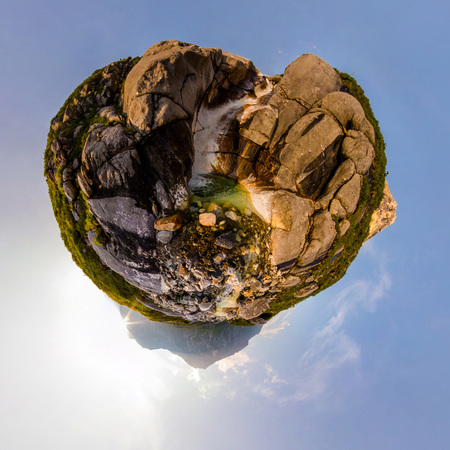 Mountain waterfall stream in sunset light in the valley. Tiny little planet 360 Фото со стока
