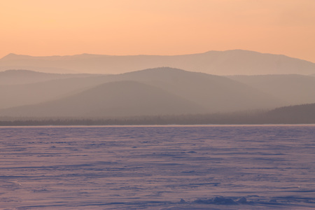 panorama winter mountain,misty hills mountain tops in pink dawn