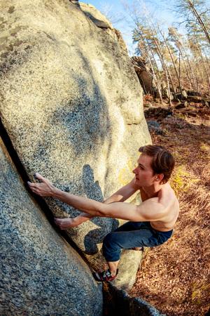 rock climber climbs a boulder over a rock without insurance Reklamní fotografie