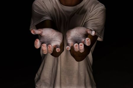 Close up hands of climber with white magnesium ready to climb
