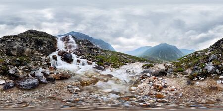 Mountain waterfall stream in misty rainy weather in the valley. Spherical panorama 360vr