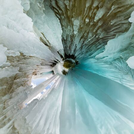 Blue Ice cave grotto on Olkhon Island, Lake Baikal, covered with icicles. Tiny little planet 360.