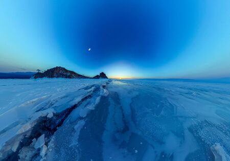 Big cracks in the ice of Lake Baikal at the Shaman Rock on Olkhon Island. Tiny little planet 360.