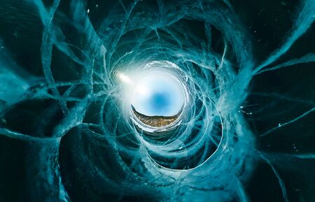 Blue ice sphere covered with cracks on a blue background, the stereographic panorama of little planet Banco de Imagens