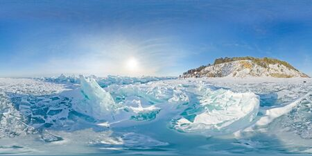 Blue hummocks of winter Lake Baikal in the afternoon under a blue sky. Spherical panorama 360vr.