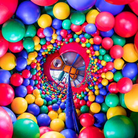 childrens playroom with colorful balls and a slide made of plastic. . Tiny little planet 360