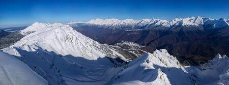 Wide Panoramic view on Caucasus mountains from the Rosa Peak. Krasnaya Polyana Rosa Khutor alpine ski resort Western Caucasus, Russia Foto de archivo