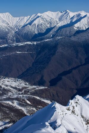 view on Caucasus mountains from the Rosa Peak. Krasnaya Polyana Rosa Khutor alpine ski resort Western Caucasus, Russia