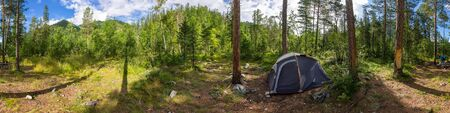 camping tent panorama in green summer forest at sunrise. Cylindrical panorama 360. Imagens