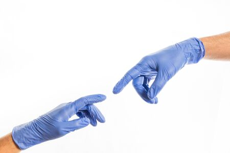 Hands of people in medical colorful rubber gloves reaching out for each other
