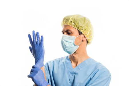 doctor in medical clothes with rubber gloves and a mask, portrait on a white background