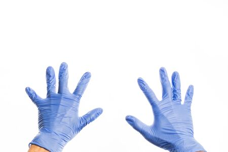 Hands of people in medical colorful rubber gloves, isolate on white background