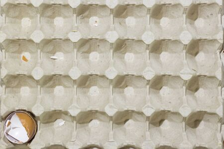 stop motion flat lay of a box with broken eggshell brown chicken eggs, background texture pattern.