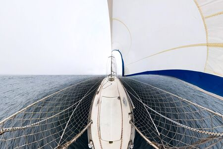 white sailing yacht sailing, view from the bow of the ship. Wide abstract panorama