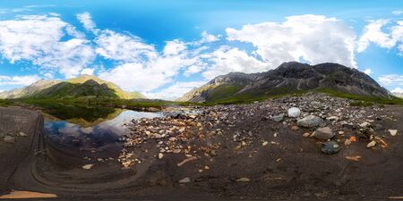 Transparent clear water of a mountain lake under a blue sky in the clouds. sand beach.Spherical panorama 360vr