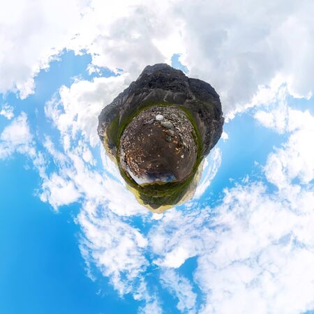 Transparent clear water of a mountain lake under a blue sky in the clouds. sand beach. Tiny little planet 360 Фото со стока