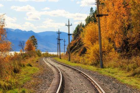 railroad rails autumn landscape, lake baikal russia