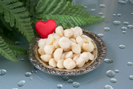 Macadamia nutson the plate  and a heart photo