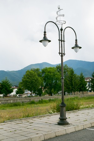 Street lamppost with the two lamps on one of the streets in Bansko, Bulgaria photo