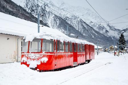 glace: alpine red train Montenvers Mer de Glace in snow
