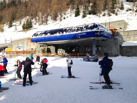 COURMAYEUR, ITALY - JANUARY 27, 2015: Cable car Dolonne and ski slopes in the mountains of winter resort Courmayeur , Italian Alps on January 27, 2015