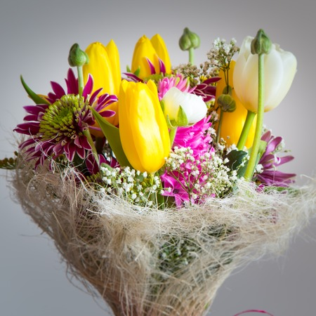 Colorful bouquet of different type spring flowers