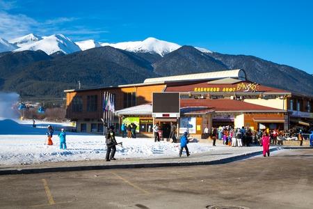 station ski: BANSKO, BULGARIA - December 2014: Bansko ski station, cable car lift and eople near it in Bansko, Bulgaria, 15 December 2014 Editorial