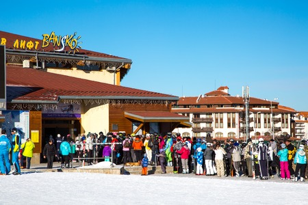 station ski: BANSKO, BULGARIA - February 2015: Bansko ski station, cable car lift and people near it in Bansko, Bulgaria, 19 February 2015 Editorial