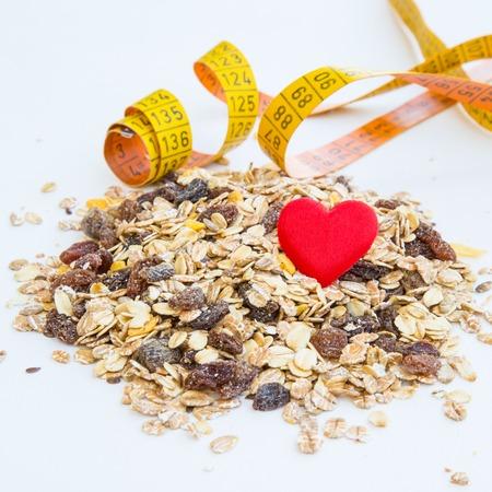 measurement tape: pile of muesli, heart and measurement tape