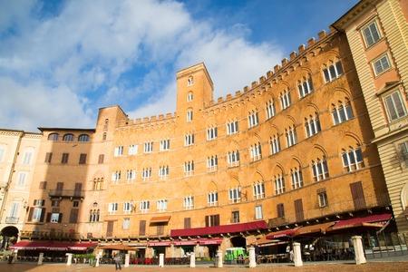 combo: Siena, Italy - November 16, 2014:  Buildings at beautiful Piazza del Combo at Siena, Tuscany, Italy