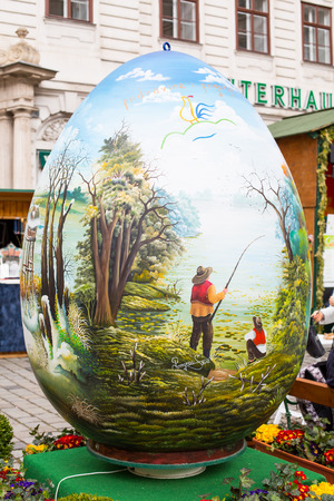 eastertime: Vienna, Austia - April, 5, 2015: Colorful big painted Easter egg at Freyung traditional market in Vienna