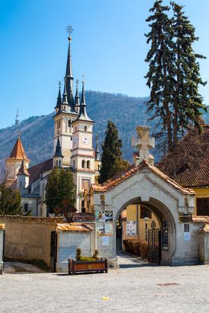 'saint nicholas': Entrance gate and Saint Nicholas Church in Brasov , Transilvania Stock Photo