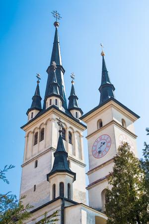 'saint nicholas': Towers of Saint Nicholas Church in Brasov, Transilvania Stock Photo